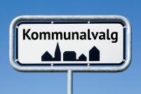 Road sign with danish text Danish municipalities elections