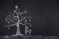 christmas concept - hinterland on a blackboard with a deer